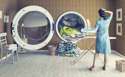Picture of lady standing in front of huge washer