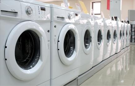 Rows of washing machines in a store