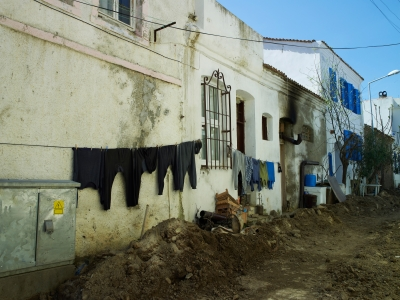 Picture of washing drying on an outside line in a rundown street
