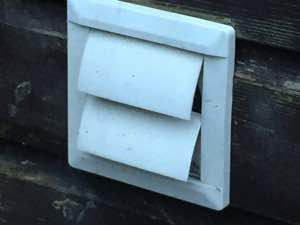 picture of a vent outside a house